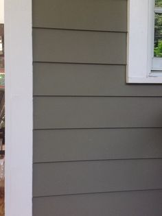 """This my exterior house color...have had several notes in my mailbox asking for it! It's a retired Duron Color called """"gristmill"""" they will mix it up for you at Sherwin Williams if you ask. It's a perfect greenish- beige-gray. Shutters and doors are greenish black."""