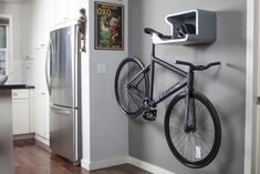 space-saving bike storage ideas for small apartments. Indoor bike storage solutions are for people who can't part with their bicycle. Hanging Bike Rack, Indoor Bike Rack, Indoor Bike Storage, Bike Hanger, Bicycle Storage, Indoor Cycling, Bicycle Rack, Bicycle Wall Mount, Bike Mount