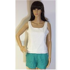 💐️WHITE EYELET TOP BY ERIN LONDON💐 Pretty eyelet top with a side zip.. Great piece to pair with jeans, shorts for casual or dressy.. Gently used. T-1 Erin London Tops
