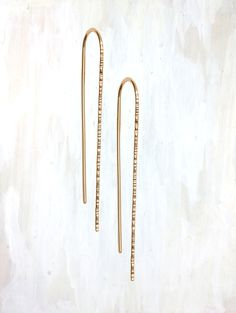 """A minimal earring that still grabs your attention and the light with texture along the front in two sizes.  Small is 7/8"""" and medium is 1 1/2"""" total length.  Both sizes available in yellow gold-fill, rose gold-fill, and sterling silver.  Pictured in medium 14k yellow gold-fill."""