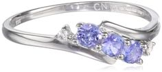 10k White Gold, Tanzanite, and Diamond Ring (0.018 cttw, GHI Color, I2-I3 Clarity)       An angled trio of diamond-flanked tanzanite stones provides a touch of soft color to this ring.     All our diamond suppliers certify that to their best knowledge their diamonds are not conflict diamonds.     The natural properties and composition of mined gemstones define the unique beauty of each piece. The image may show slight differences to the actual stone in color and texture.