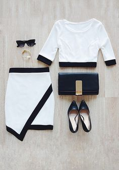 Black-lined white asymmetrical skirt with a crop top, black pointed shoes, black purse and accessories