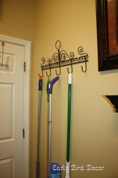 SO simple, why didnt I think of this! Coat rack to hang mop, broom, dust pan, etc. in the Laundry room