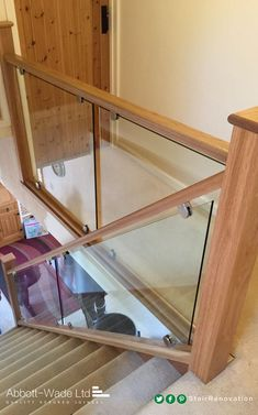 wooden handrail with a glass balustrade