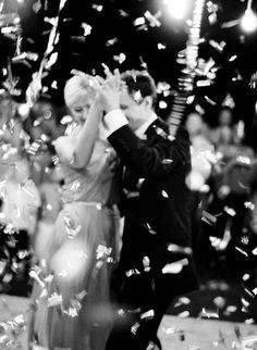 How cool would it be to have confetti fall for the first dance - photography by Jose Villa