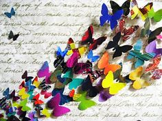 Butterflies on words. The butterflies could easily be repurposed from paper scraps, or even colorful magazing pages.
