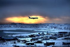 An evening shot of a plane leaving Iqaluit, the capital of Nunavut. So remote, so cold, and so beautiful.