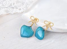 Dangle blue hydrangea earrings with golden bow.  Sterling silver Studs with real flower petals. Resin jewelry with real flower. Botanical. by OneFlowerStory on Etsy