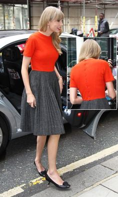 Taylor Swift's red back button top and grey pleated skirt