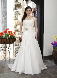 Sincerity plus wedding dress style 4552 Modified sweetheart neckline with draped taffeta bodice and accented  with a beaded motif at the hip flows into an A-line skirt. The style  features a corset back and a chapel length train. Comes with a taffeta  shawl.