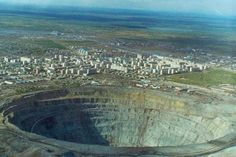 The Mir diamond mine in Russia is 3/4 of a mile wide and 1/2 mile deep, so big that the airspace above the mine was closed after several helicopters were sucked in by downdrafts.