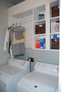 Laundry room organization - hanger idea  Really like this with the shelves and clothes hanger