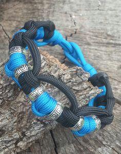 Handmade Paracord Survival Bracelet.. love the decorative silver tone beads…