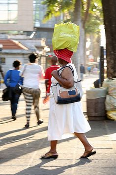 Carrying a shopping bag - still see things being carried on the head ...