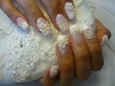 Wedding day manicure matching the beading and lace embroidery of your bridal gown. Love the little pearls especially.