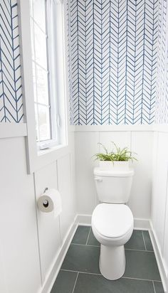 Lake house powder room featuring Serena and Lily feather wallpaper in blue. Slate tile and a crisp white and blue color scheme give a coastal vibe. wallpaper bathroom Lake House Powder Room - The Lilypad Cottage Serena And Lily Wallpaper, Blue And White Wallpaper, Wc Decoration, Small Toilet Room, Toilet Room Decor, Powder Room Wallpaper, Small Bathroom With Wallpaper, Wallpaper For House, Cloakroom Wallpaper