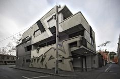 Normally adorning the sides, ITN Architects has taken graffiti to a whole new level. For this building in Melbourne, the architectural firm decided to hire a graffiti writer to have their work built i...