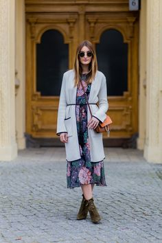 BERLIN, GERMANY - MARCH 29: Fashion blogger Sofia Grau is wearing a green pink dress with floral print and grey long cardigan from Zara, bag Chloe Faye, belt vintage, sunglasses Rayban, olive shoes Aquazzura tribeca boots on March 29, 2016 in Berlin, Germany (Photo by Christian Vierig/Getty Images)