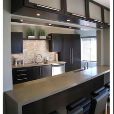 modern kitchen with putty colored counter tops