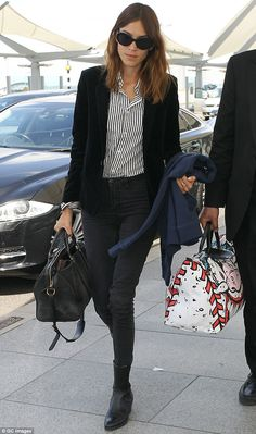 You can take the girl out of London: Alexa Chung arrives in Japan channeling Slone style in striped shirt, velvet blazer and Chelsea boots | Mail Online