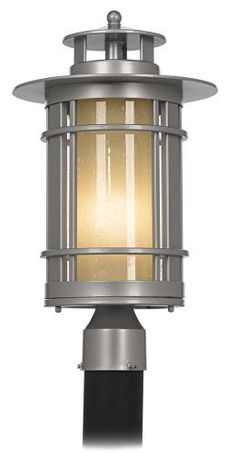 "Argentine 18"" High Brushed Steel Outdoor Post Light by Universal Lighting and Decor. $149.99. This ultra-chic brushed steel outdoor post light with rim will bring high style to your outside. A cylinder of warm amber glass is surrounded by an eye-catching modern industrial housing with a stylized nautical rim. Hook up to the pole of your choice to personalize this sophisticated outdoor accent. Post not included."