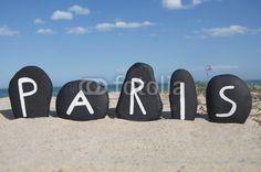 Paris, capital of France, souvenir on black stones over the beach