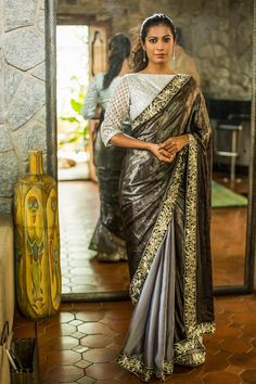 A glistening black silver foil printed half with a grey flat chiffon half. Fabulously detailed with a black and silver thread work border. Truly divalicious!A silver blouse for a softer glam. A black blouse for an edgier glam. #black #grey #saree #India #blouse #houseofblouse