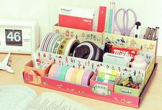 Kawaii folded card stationary (or cosmetics) desk organiser. For more/similar see http://www.aliexpress.com/product-fm/452504301-DIY-Desk-Boxes-Cute-Lovely-Pink-Desk-Personal-Stationery-Cosmetic-Organizer-Clear-up-Box-9-Slots-wholesalers.html    Want. Just...want. I'd love an organiser like this for my bureau