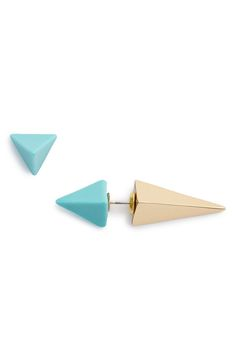 Small pyramids in turquoise and hold add a modern touch to these trendy stud earrings.