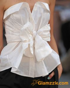 A men's button up turned into a fly tube top! I tried it w/my hubby shirt and it is super easy!! Just put the shirt around your bust, button the shirt down, and tie the sleeves into a bow! :-) Cute but I think my bust might be too big for this!