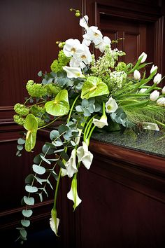 Lime-green anthurium, white phaelonopsis, silver-green eucalyptus, and lorashen make the perfect arrangement for any funeral or memorial service. Arrangements Funéraires, Funeral Floral Arrangements, Church Flower Arrangements, Church Flowers, Beautiful Flower Arrangements, Funeral Flowers, Beautiful Flowers, Gladiolus Arrangements, Ikebana