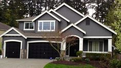 Hmmm.  What would happen if we painted our front door & garage door black? Would it balance out the black roof?