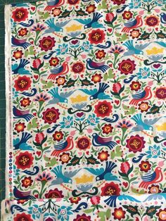 La Paloma Birds and Flowers Folklorico This is a beautiful Mexican Folk Art fabric of large stylized birds floating round bright vibrant flowers. This reminds m