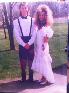 Bad Prom Photos.  I didn't have the big hair, but I do recall having a dress like that. The 80s wasn't good to anyone. Ha ha