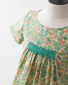 liberty + bonpoint, I really like the tight, tailored look of this smocked dress/top.