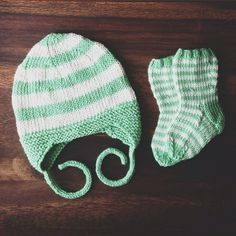 Mint green beanie and socks knit with the ever so lovely Amy Butler yarn...some of the best yarn ever.  #knitting #handmade #yarn #diy #amybutler #socks #babyhat #gift #ravelry #craft