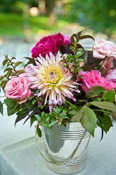 flowers in a bucket.  cute & rustic .