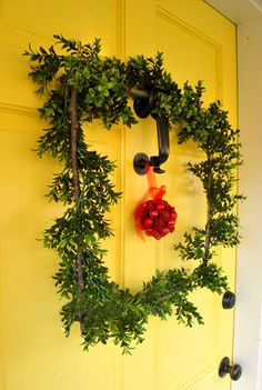 Simple Square Wreath made with 4 sticks and faux boxwood garland. {Young House Love}