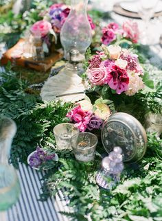 Eclectic table of vintage items and gorgeous flowers. #Garden #wedding