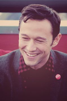 Joseph Gordon-Levitt wearing his usual black and red shirt with his hitRECord pin