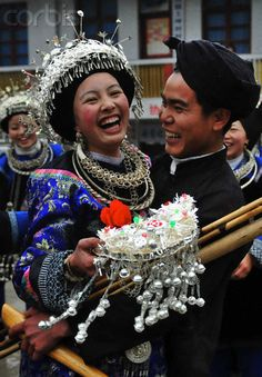 China | The bridegroom (Miao ethnic group) embraces his bride on their wedding ceremony held in a village of Sansui County, Guizhou Province | © Qin Gang/Xinhua Press/Corbis