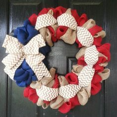 Classic red, white, & blue burlap door wreath accented with a white chevron ribbon and bow. Perfect for any door.