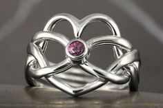 Pink sapphire heart shape puzzle ring