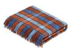 A vibrant cosy blanket by Bronte by Moon. Perfect for taking your living room or bedroom from Summer to Autumn. See more my top curated autumn home accessories (most are super affordable)