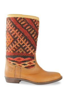 Handmade one-of-a-kind boots with a unique combination of original vintage kilim rugs and leather. Available at www.kiboots.com