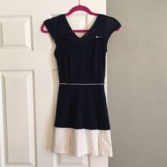 Nike tennis dress Navy dress with a mesh top. Under the mesh part is a built in sports bra. Size XS Nike Dresses Mini