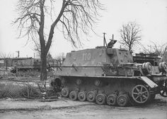 A abandoned Sturmpanzer 4 'Brummbar' nr. 110 with a second 'Brummbar' sitting in the distance during 1945