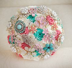 Brooch bouquet. Deposit on a Coral, Ivory and Mint wedding brooch bouquet, Jeweled Bouquet. Made upon request. $60.00, via Etsy.