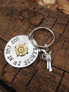 Got you in my sights quote hand stamped with bullet and gun key chain for the… Ammo Jewelry, Silverware Jewelry, Spoon Jewelry, Metal Jewelry, Jewelry Crafts, Jewelery, Shotgun Shell Crafts, Shotgun Shell Jewelry, Shotgun Shells