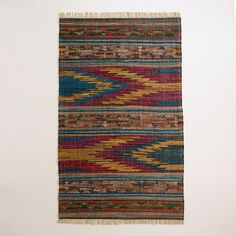 Our 5'x8' Kaida Kilim Flatweave Area Rug is handwoven in a geometric pattern inspired by traditional kilim rugs. This eco-conscious, flat-woven rug features our bright exclusive design.